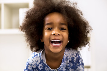 Smiling beautiful african girl with healthy teeth