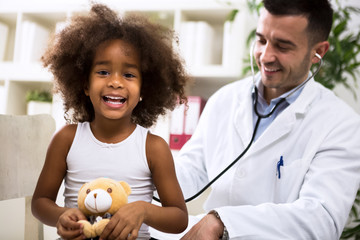 Pediatrician doctor examining kid