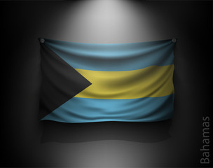 waving flag bahamas on a dark wall