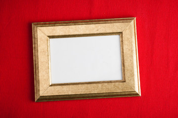 Golden vintage frame with red background