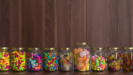 Various sugary candy in a class jar
