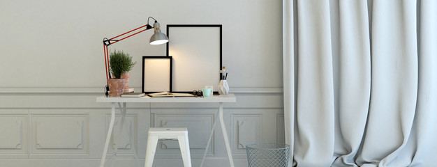 Blank picture frames illuminated by a lamp