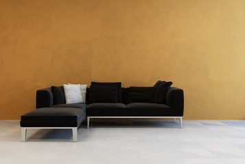 Simple modern black corner couch on a brown wall