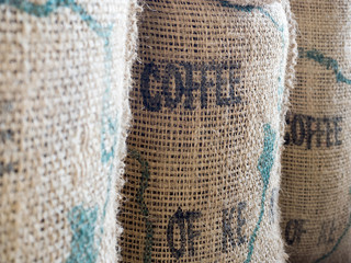 Close up of textured woven hessian fabric with the word Coffee s