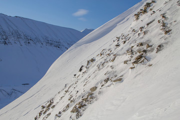 The texture of the snow-capped mountains. Spitsbergen (Svalbard)