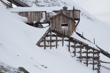 Exterior of an abandoned Arctic coal mine buildings in Longyearbyen