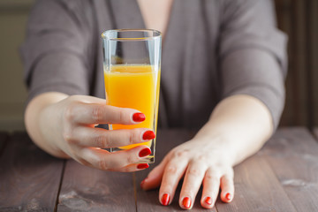 Woman offering orange juice