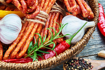 Snack stick sausages in a wooden basket