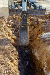 excavator in a city street for the construction of a new infrastructure line.optical fibers