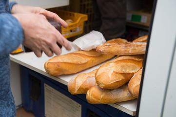 Deurstickers Bakkerij Buying French bread