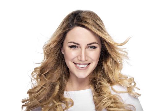 Attractive blonde smiling woman portrait.