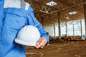 construction worker with a helmet in his hand