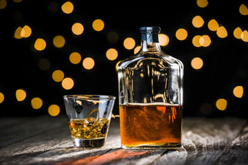 a bottle and glass of whiskey