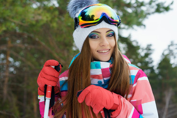 A skiing girl in bright sport clothes