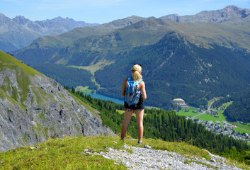 Hiker looks at the alpine city Davos. Canton Graubunden - Switzerland