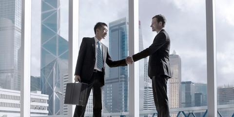 Asian Business Handshake Agreement Partnetship Concept
