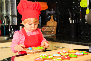 little girl making easter cookies in kitchen