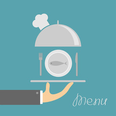 Hand holding silver platter cloche with chefs hat and plate fish, fork, knife. Menu card. Blue background. Flat design.
