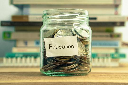 money saving for education in the glass bottle for money concept