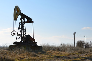 Small Pumpjack in field