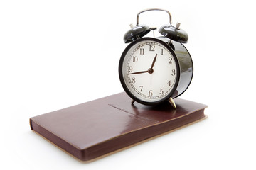 Notebook and clock in retro style