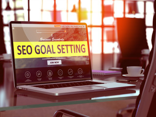 Modern Workplace with Laptop showing Landing Page with SEO - Search Engine Optimization - Goal Setting Concept. Toned Image with Selective Focus. 3D Render.