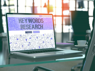 Keywords Research - Closeup Landing Page in Doodle Design Style on Laptop Screen. On Background of Comfortable Working Place in Modern Office. Toned, Blurred Image. 3D Render.