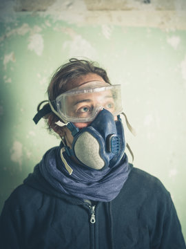 Young woman with dust mask and goggles