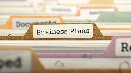 Business Plans Concept on Folder Register in Multicolor Card Index. Closeup View. Selective Focus. 3D Render.
