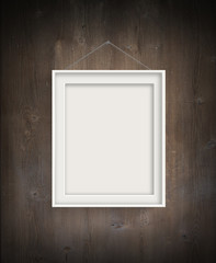 White frames on Wooden wall