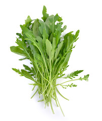 Sweet rucola salad or rocket lettuce leaves isolated on white ba