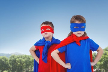 Composite image of masked kids pretending to be superheroes