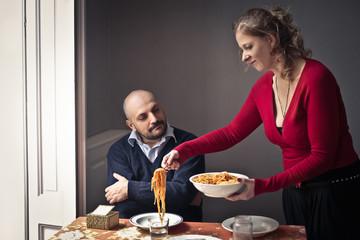 Wife serving dinner
