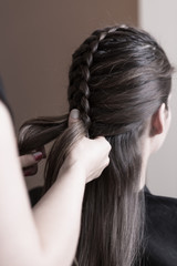 Hairdresser making a dutch braid