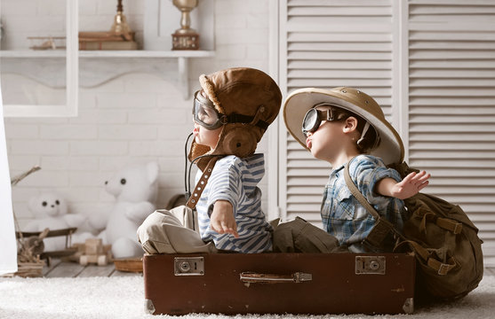 Boys in images traveler and pilot play in his room