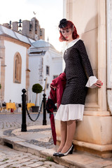 young redhead girl on a retro vintage dress