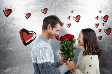 Composite image of romantic couple holding red roses