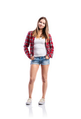 Girl in shorts and shirt, hand in pockets, isolated