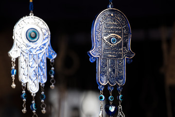 Close view of the popular Hamsa palm shaped amulet.