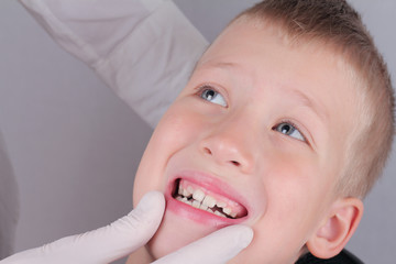 Kid in dentist chair. Child dental care, orthodontics, putting dental braces