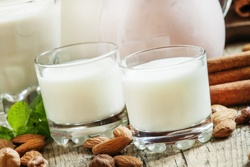 Fresh dairy products and nuts on an old wooden background, selec