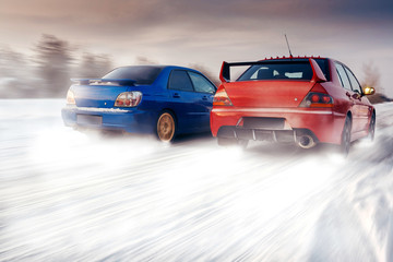 Two cars compete in race at winter