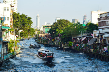 The picture illustrates the wonderful variety that Bangkok has to offer in terms of city environment. The environment offers everything from green trees to diverse city architectural styles.