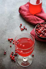 Cranberry juice on a dark background