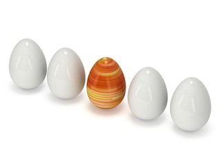 Easter egg in a row of the white eggs