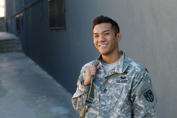 Happy healthy ethnic army soldier with copy space on the left