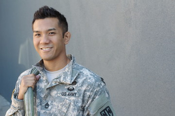 Young ethnically ambiguous American soldier with backpack and copy space on the right
