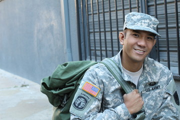 The portrait of the smiling US Army soldier