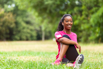 African american woman jogger stretching  - Fitness, people and