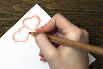 hand draws two hearts pencil